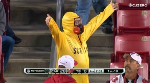 Okay, this is a Buccaneers fan in a biohazard suit akin to Walter White. Very different story. But crazy just the same. Wonder if he gets hot in there.