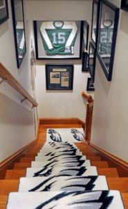Because in order to match the Eagles memorabilla, you must have Eagles hallway carpet. Couldn't a plain white carpet do just fine? Or better yet, how about just leave the plain old wooden floor alone.