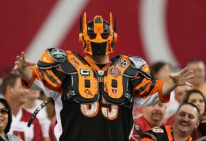 He even has the shoulder pads and jersey to match. Which begs the question for me.