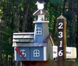 Yes, it's another lighthouse mailbox. But this one is made from wood, painted, blue and much smaller than the other one.
