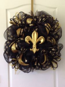 """Had to include at least one New Orleans Saints wreath on this post. This one has """"Saints"""" on one of the ribbons."""