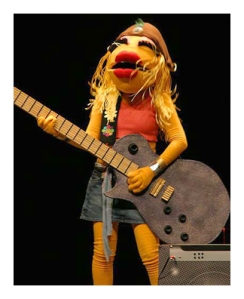 She's clearly based on Janis Joplin despite the wardrobe. But she loves to play her Les Paul.