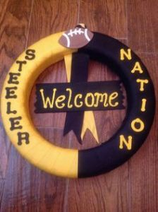 Another simple Steeler wreath. Only this one uses only black and gold yarn, ribbons, and letters.