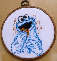Here he is eating his cookie and spreading crumbs everywhere. Yeah, Cookie Monster isn't known for his table manners.