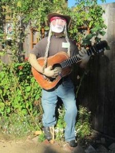 That's a very good Willie Nelson scarecrow. The braids are excellent. Brilliant.
