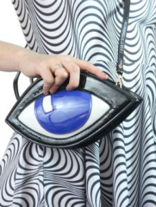Well, at least it's not an eyeball purse. Now that would be disgusting. But this one is quite creepy.