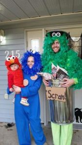 Well, he's Oscar the Grouch. Yet, he and Cookie Monster sure have fuzzy heads.
