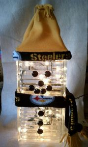 Yes, I know it's another Steeler snowman. But this one is made from glass blocks and lights up. That's different. Still, it's adorable.