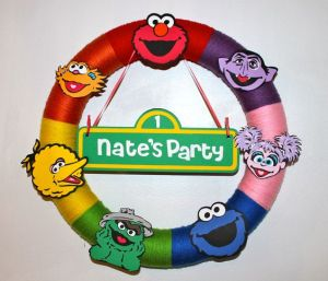 Well, this is for a little kid's party. Includes Elmo, the Count, Abby Cadabby, Cookie Monster, Oscar, Big Bird, and Zoe. So cute.