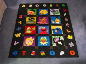 This one has the alphabet all around the border. And it has your favorite Muppets in the squares.