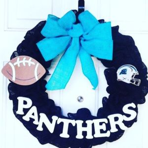 This only uses a rather simple design with a football, helmet, name, and ribbon. Love the ribbon though.
