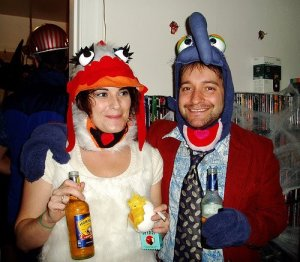 You understand she's a chicken. And it seems these two are drinking and smoking at this party.