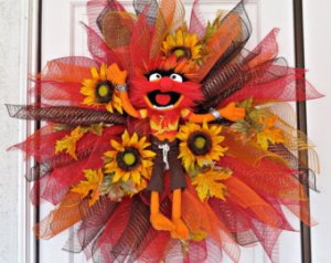 Well, the Animal in the center of this deco mesh wreath is plush. But he certainly seems happy.
