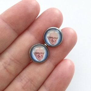 Because there's nothing more stylish than wearing earrings with an old man's face on them. Yeah, that's ridiculous.