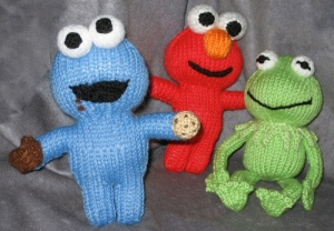 Includes Cookie Monster, Elmo, and Kermit. Cookie Monster even has his own cookie he's eating.