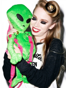 Well, it's called a lost ET backpack. But this girl seems to really like her little green backpack man.