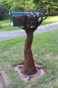 Then again, that's not really a tree. And the mailbox is supposed to be held up in the branches.