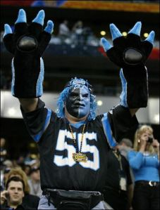 And with the pig paws this guy certainly has. Even has his face painted and blue hair to boot.