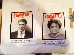 This shirt was made when he was under indictment for abusing his gubernatorial office. The person on the back is a DA who was prosecuting him.