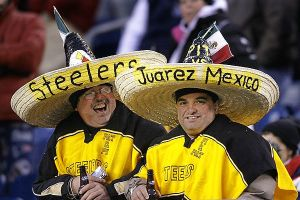 You can tell by their black and gold ponchos and sombreros. But they must be very diehard fans to travel this far.