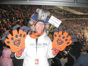 Here is this guy with foam paws and a bear hat. And he seems really psyched up for the game.