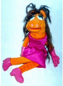 I think this might be a knock off. Still, seems more like Miss Piggy if she woke up hungover in a tanning booth. Or her as Snookie from Jersey Shore.