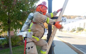 Unfortunately, he may not be able to survive the flames since most scarecrows are extremely flammable. This was made by a town fire department.