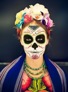 Well, she has a pink skull face with beautiful flowers in her hair. The clothes aren't too shabby either.