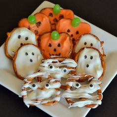 These consist of jack-o-lanterns, ghosts, and mummies. The last one is all in wraps with icing.