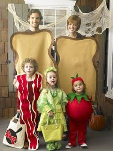 The parents are the bread slices while the kids are bacon, lettuce, ant tomato. I guess one the parents picked the theme that year.