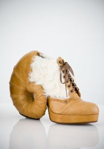 I have to put this on my post since my sister went to VCU. Their mascot is a ram. This shoe has a ram's horn.