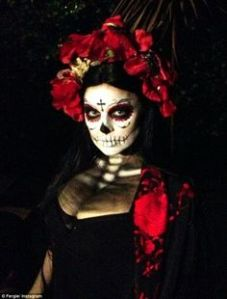 She even has a cross on her skull makeup. Love the roses in her hair.
