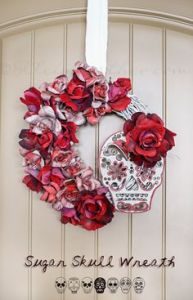 Yes, roses and skulls seem to go together during Dia de los Muertos. This one is a red and white variation.