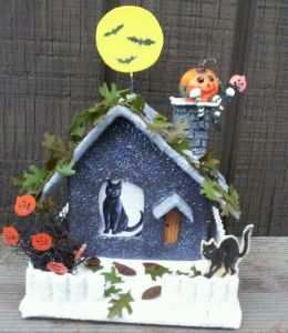 This one has a black cat inside as well as a pumpkin on the chimney. Not sure about the snow though.