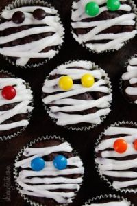 Don't forget to add M&Ms as the eyes. That along with white drizzle on the chocolate cupcake.
