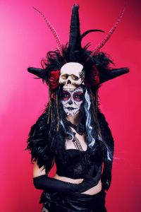 You might see that a lot of Dia de los Muertos costumes do contain feathers and skulls on them. Then again, it's to be expected.