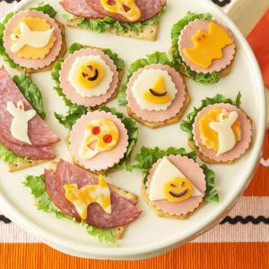 Each of these has a ghoulish Halloween surprise in cheese. And each has its own lunch meat backdrop.