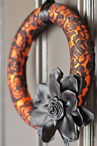 Said to be made from a pool noodle and a black lace stocking. Love the flower.