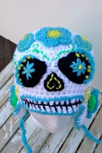 This one has blue flowers on it. Sure it's kind of freaky but it's well suited for Day of the Dead.