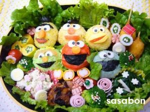 This one includes rice balls of Bert, Ernie, Big Bird, Oscar, Elmo, and Cookie Monster. And they're surrounded by salad.