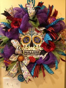 Has a colorful skull in the middle. And yes, the colors seem festive for a time of remembrance. But this is a Mexican holiday.