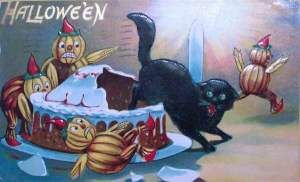 Okay, did those pumpkin guys try to bake that cat in a cake? Or did the cat just pounce on it to scare the freaky pumpkin people away? At any rate, the cat has every right to be pissed.