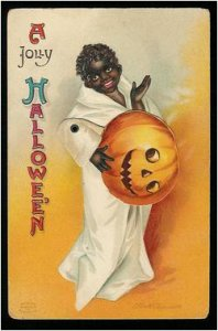 I think it would've been better if the kid just kept his pumpkin hat on. Because he's a walking racist stereotype. Of course, you must expect these things from vintage cards.