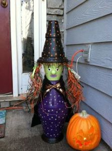 Doesn't hurt she has a flower pot hat to match. And that she's near a pumpkin.