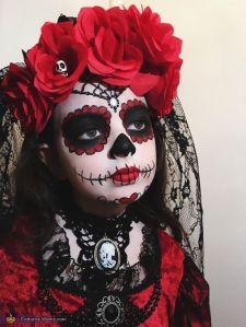 For the record, there are Dia de los Muertos celebrations devoted to children and adult souls on separate days. Still love the flowers and lace.