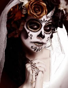 Well, she has a nice white dress with her skull makeup as well as matching flowers in her hair. Love it.