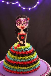 Kind of resembles a Mexican Tim Burton character. Love the skirt.
