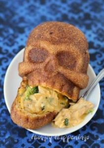 Guess these skulls come breaded. At any length, at least there's no blood or brains instead. Just cheese and broccoli.