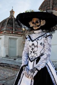 This is fairly close to a traditional Catrina which was a figure of Mexican satire on the upper class. And yes, she dressed like the Dowager Countess from Downton Abbey.