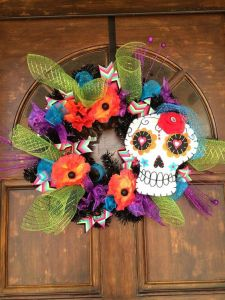This one has so many decorations going for it. Love the skull with heart eyes and veil.